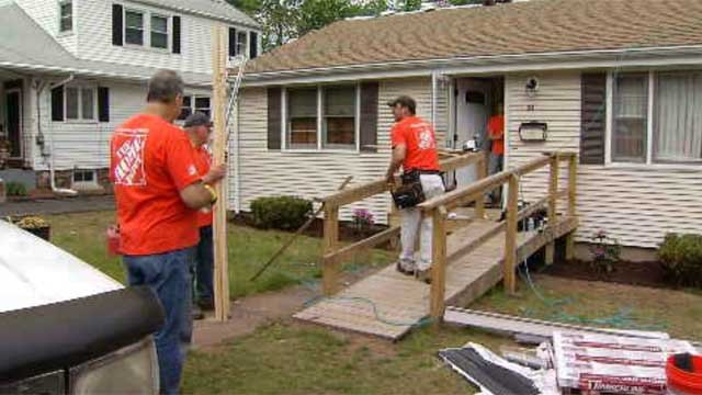 On Thursday, workers from Home Depot helped out a World War II veteran in Glastonbury. (WFSB)