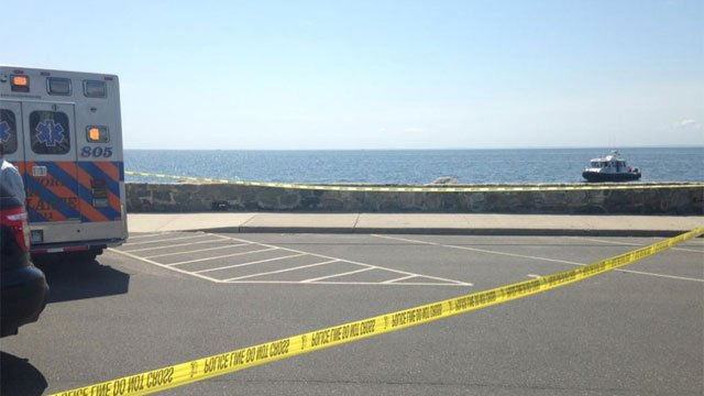 Stratford police and EMS are on scene by the Lordship seawall after a body washed up on shore. (WFSB)