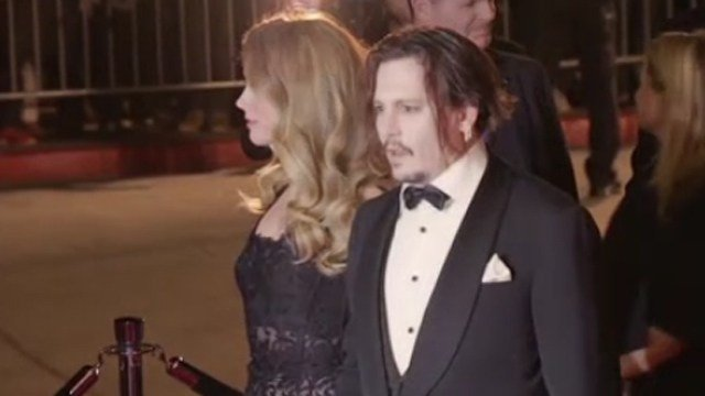 Amber Heard and Johnny Depp. (CBS photo)