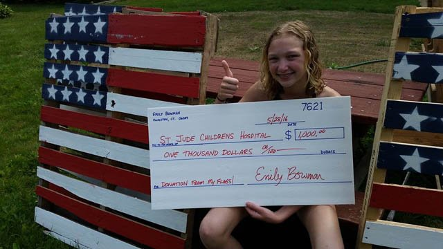 Emily Bowman and her donation check. (Family photo)