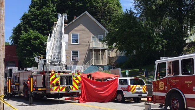 Firefighters battling fire at home in Norwich. (WFSB)