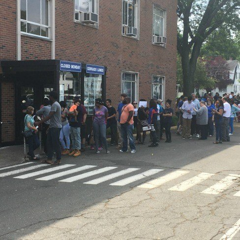 Line outside the Wethersfield DMV Saturday after a computer problem caused issues with registration.