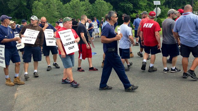 Teamsters protesting outside HDI in Manchester on Wednesday morning. (WFSB)