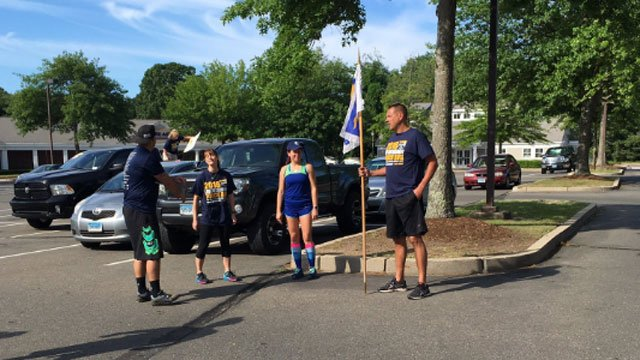 Officers and athletes geared up for the kick off of Special Olympics Connecticut Torch Run. (WFSB)