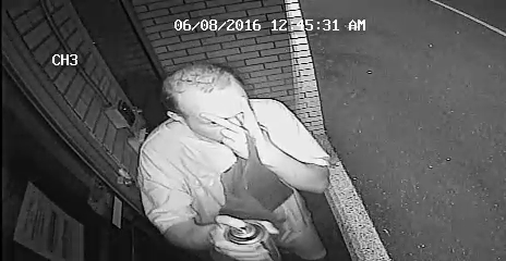 New Haven PD are looking for this man who allegedly sprayed graffiti on numerous buildings. (New Haven PD)