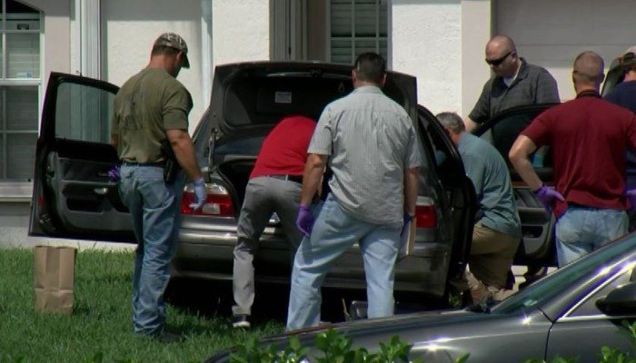 Authorities search a vehicle looking for evidence connected to the Orlando terrorist attack. (Source: WPEC via CNN)