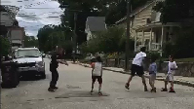 An officer played a game of pickup basketball in Willimantic. (Edith Gonzalez/iWitness photo)