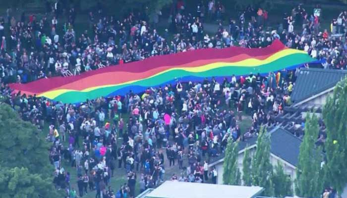 A huge crowd gathered in Seattle, WA Sunday to mourn those killed in Sunday morning's mass shooting in an Orlando nightclub, in which 50 people were killed.  (Source: CNN)