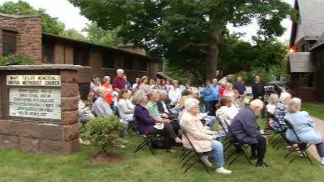 Dozens of mourners gathered outside a Milford church to honor the victims in Orlando and pray for peace. (WFSB)