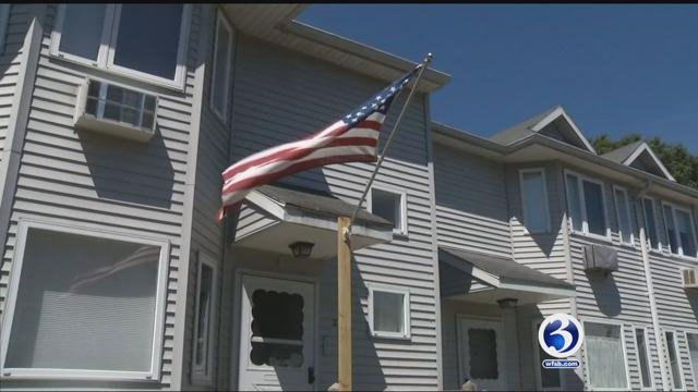 An Air Force veteran said he's facing condo fines for flying the American Flag in the front of his unit instead of the back. (WFSB)