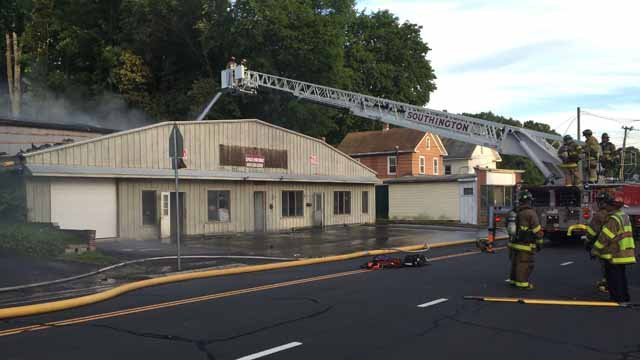 Crews battle fire at vacant building in Southington. (WFSB)