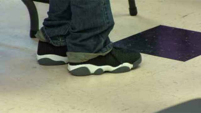 New shoes and a pizza party were waiting for more than 30 children in need at My Sister's Place in Hartford on Thursday. (WFSB)