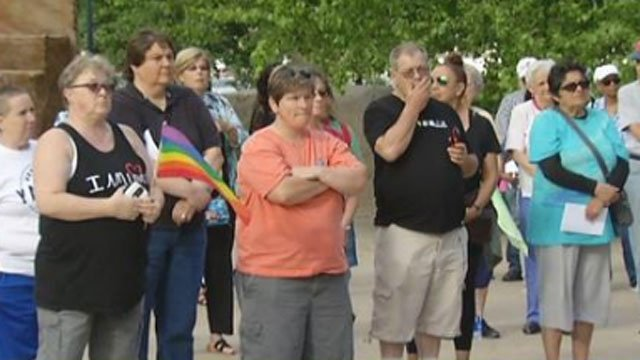 Dozens gathered for a vigil for Kim Morris and the other Orlando shooting victims. (WFSB)