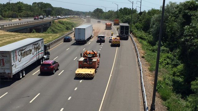 Crews cleaned a fuel spill after a crash on I-91 in North Haven. (WFSB)