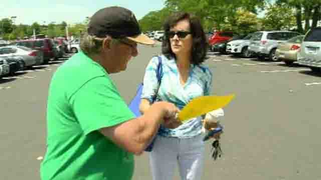 HDI workers were out passing out fliers on Thursday to inform them about the lock-out. (WFSB)