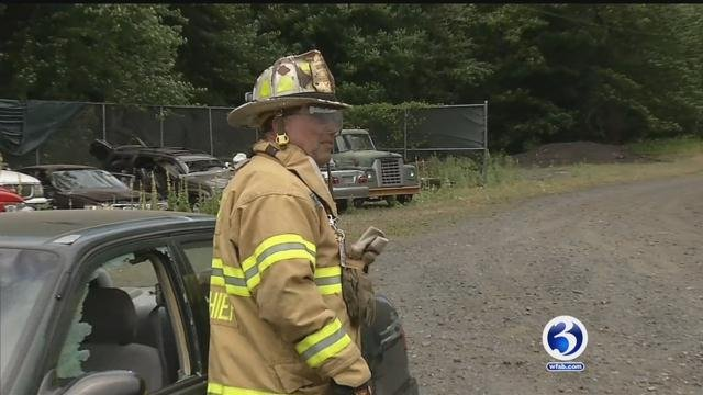 Glastonbury firefighters show how they would save a child in a hot car. (WFSB)
