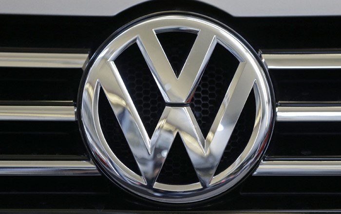 Volkswagen will spend $14.7 billion to settle consumer lawsuits and government allegations that it cheated on emissions tests in what lawyers are calling the largest auto-related class-action settlement in U.S. history. (Source: AP/Gene J. Puskar)