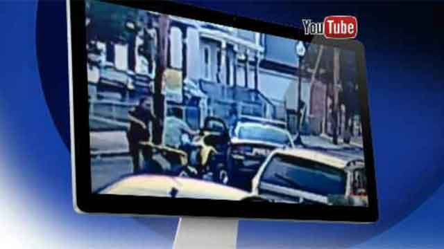 The YouTube video shows 19-year-old Phil Giacobbe riding his ATV down East Main Street, when anofficerpulls in front of him. (WFSB)