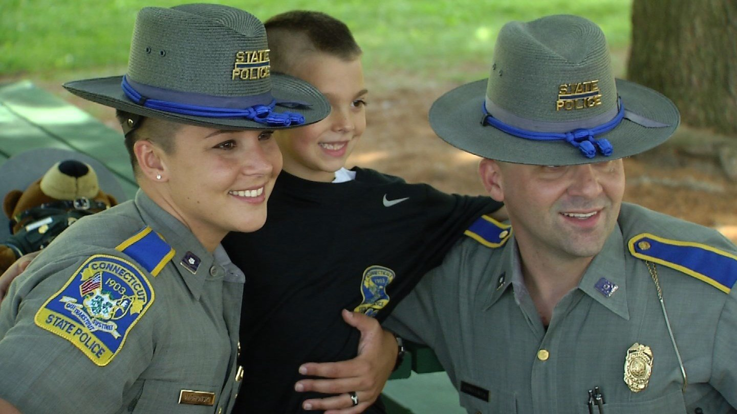 Trooper Kaila Michonski reunites with Austin McLean after his father was shot and killed one year ago. (WFSB)