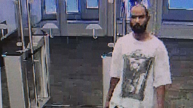 A surveillance photo of the man who walked into a Travelers building in Hartford. (Source photo)