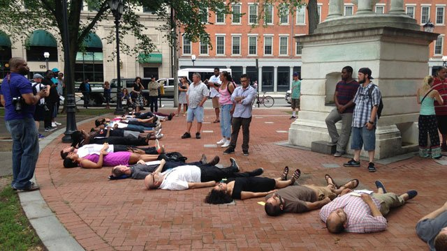People participate in 'die-in' protest in New Haven. (WFSB)