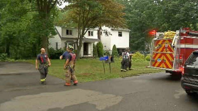 Crews battled a fire at a home in Farmington on Sunday morning. (WFSB)