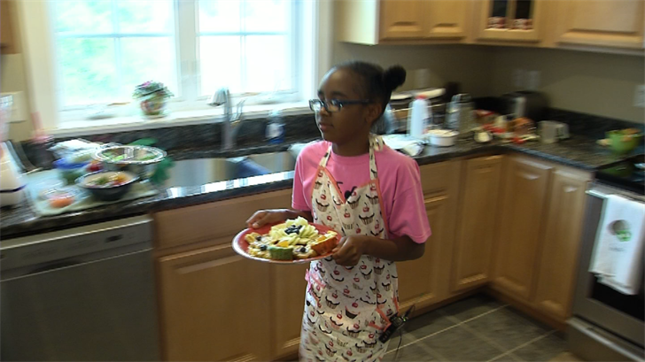 Ten-year-old Kalaya Moore will meet the First Lady after winning a cooking contest. (WFSB)