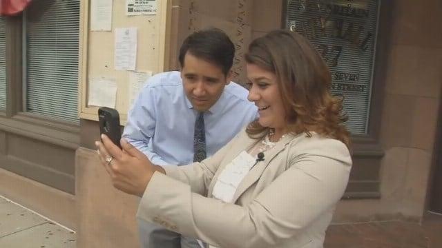 WFSB reporter Matthew Campbell and New Britain Mayor Erin Stewart hunt for Pokemon. (WFSB)