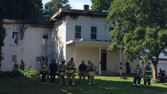Meriden firefighters battled house fire on Britannia Street on Monday. (WFSB)