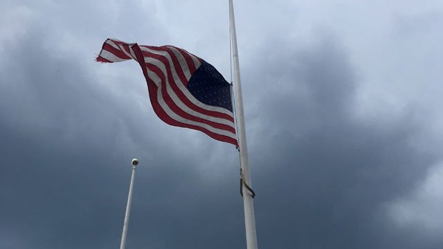Flags were flying at half-staff at Hartford Police Department in honor of those who lost their lives. (WFSB)
