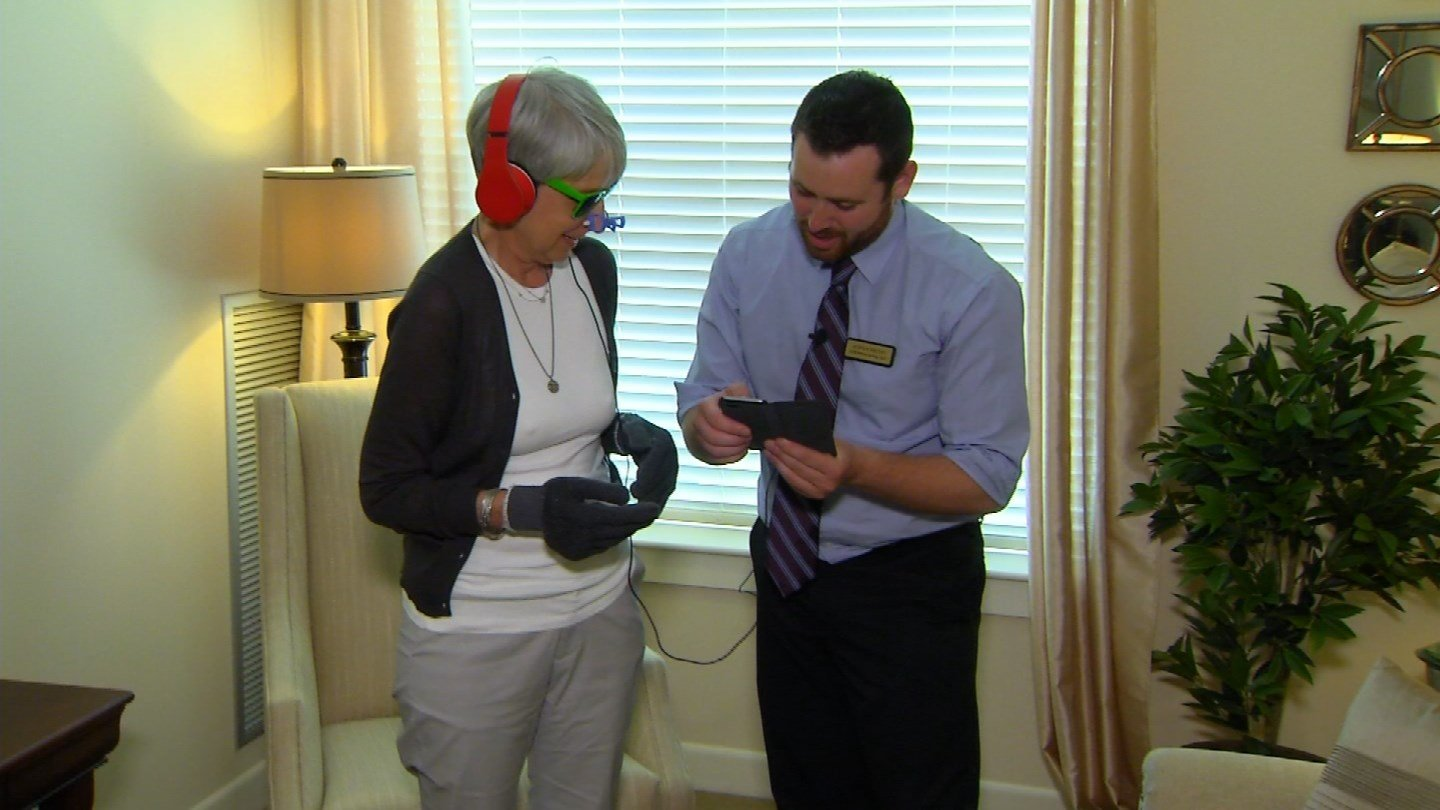 Linda Fahn uses a dementia simulator to understand her mother's condition. (WFSB photo)