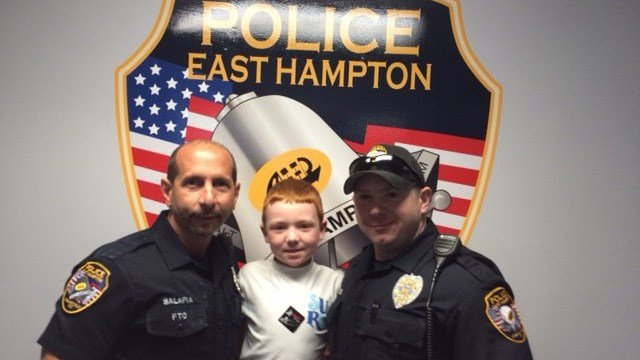 Police said this 7-year-old used his birthday money to buy them bagels and doughnuts. (East Hampton police photo)