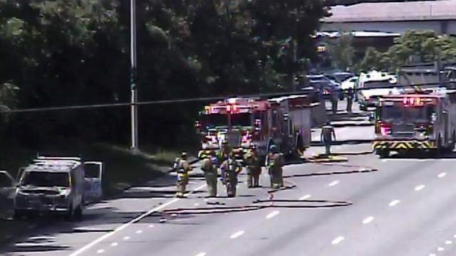 Firefighters on the scene of a van fire on I-84 in West Hartford. (CT DOT)