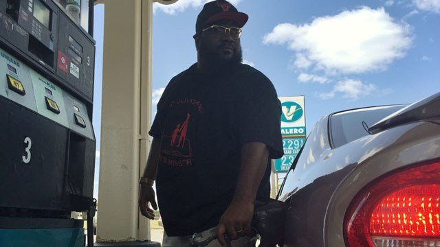 A driver fills up at a Valero station in Hartford as a church gives away free gas. (WFSB photo)