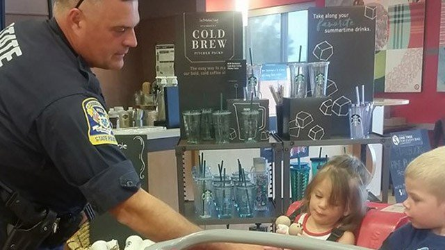 A state trooper was photographed buying cake pops for Heather Dyer's children. (Facebook photo)