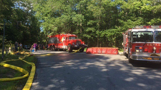 Firefighters responded to a home engulfed in a fire. (WFSB)
