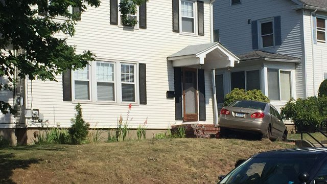A motor vehicle crashed into the porch of a home in Hartford on Monday morning. (WFSB)