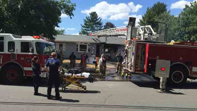 Crews battled a garage fire in Enfield on Tuesday. (WFSB)