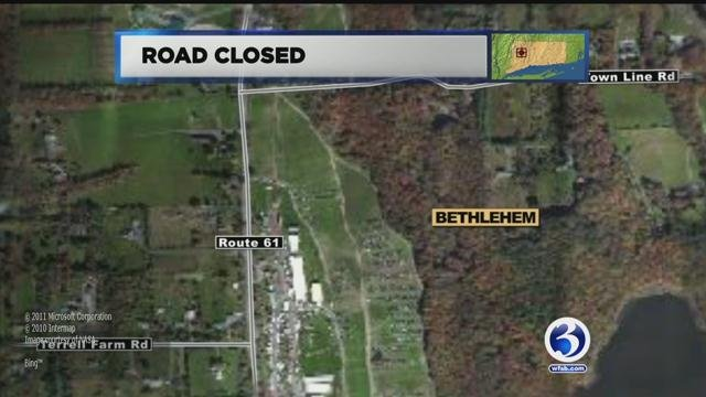 A motor vehicle crash involving a box truck closed Route 61 in Morris on Tuesday morning. (WFSB)
