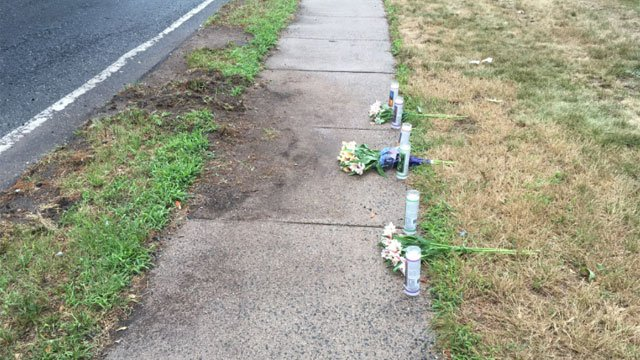 Flowers and candles were found at the crash sight. (WFSB)