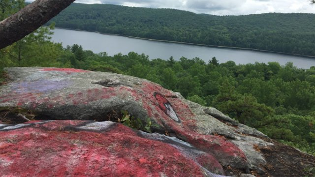The town of Barkhamsted said someone defaced Beach Rock with graffiti. (WFSB)