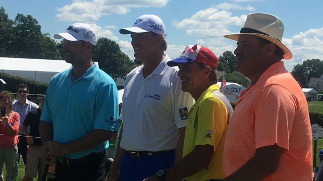 Chris Berman Tim Wakefield Doug Flutie And Ernie Els pose for the photo before teeing off. (WFSB)