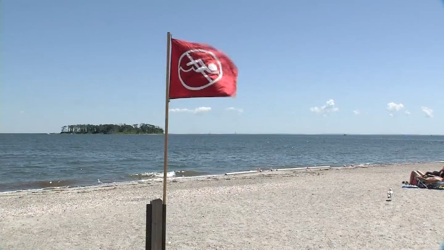 A red flag warns swimmers of high bacteria levels at Silver Sands State Park beach in Milford. (WFSB photo)