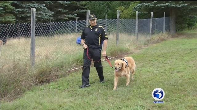 Retired Lieutenant Colonel John Charles said 4-year-old Dozer changed his life forever. (WFSB)