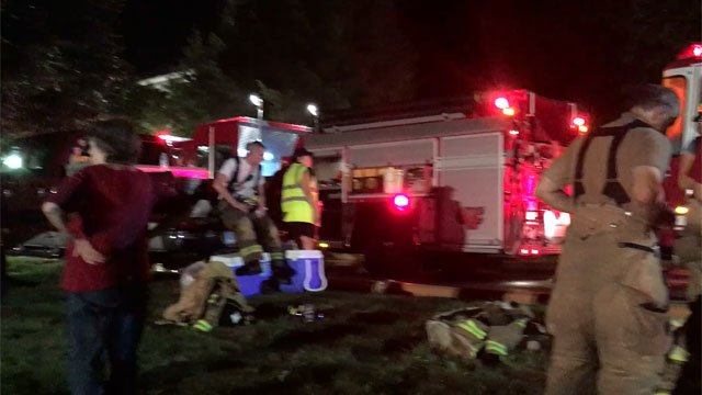 Firefighters recover after a house fire in Winsted. (WFSB)