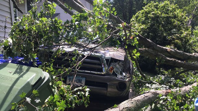 A Middletown resident found his 2010 Toyota flattened after Thursday's storm. (WFSB)