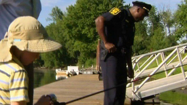 Officers come together with children by fishing (WFSB).
