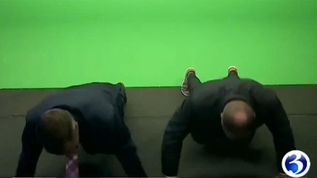 WFSB's Eric Parker and Scot Haney do the #22PushUpChallenge during a live broadcast. (WFSB photo)