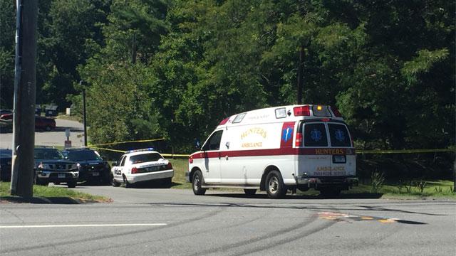 A body was found near a condominium complex in Meriden on Tuesday afternoon. (WFSB)