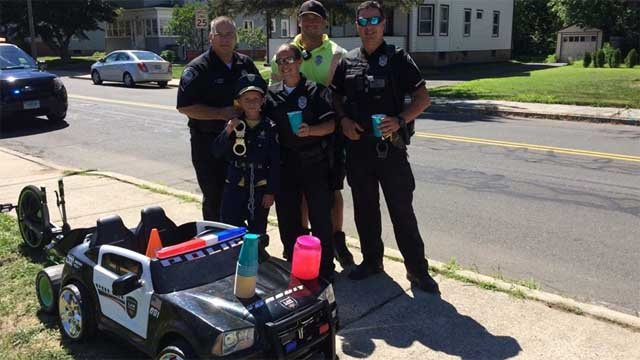 Officers Tom Gorr, Matt Hammell, Kristy Rochette,Russ Veranali, and the newest recruit (Southington Police)